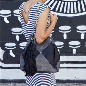 Patchwork black backpack purse.
